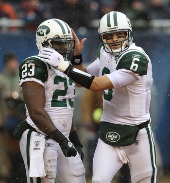 CHICAGO, IL - DECEMBER 26: Mark Sanchez #6 of the New York Jets congratulates Shonn Greene #23 after a touchdown against the Chicago Bears at Soldier Field on December 26, 2010 in Chicago, Illinois. The Bears defeated the Jets 38-34. (Photo by Jonathan Da