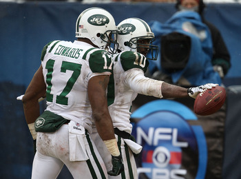 CHICAGO, IL - DECEMBER 26: Santonio Holmes #10 of the New York Jets celebrates a touchdown catch with teammate Braylon Edwards #17 against the Chicago Bears at Soldier Field on December 26, 2010 in Chicago, Illinois. The Bears defeated the Jets 38-34. (Ph