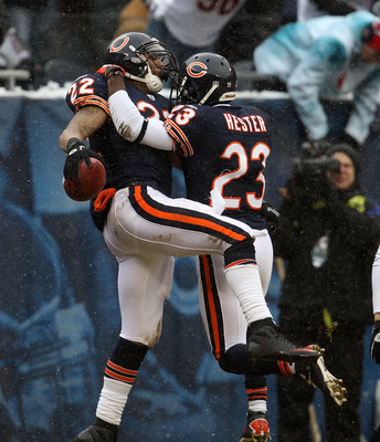 CHICAGO, IL - DECEMBER 26: Matt Forte #22 of the Chicago Bears is greeted by teammate Devin Hester #23 after scoring a touchdown against the New York Jets at Soldier Field on December 26, 2010 in Chicago, Illinois. The Bears defeated the Jets 38-34. (Phot