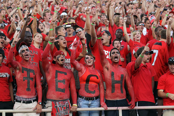 LUBBOCK, TX - SEPTEMBER 18:  Fans of the Texas Tech Red Raiders cheer against the Texas Longhorns at Jones AT&T Stadium on September 18, 2010 in Lubbock, Texas.  (Photo by Ronald Martinez/Getty Images)
