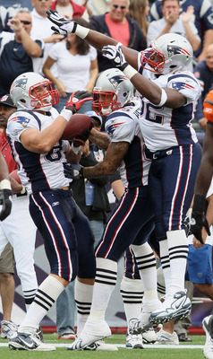 FOXBORO, MA - SEPTEMBER 12:  Rob Gronkowski #87 of the New England Patriots celebrates his touchdown wit teammates Alge Crumpler #82 and Aaron Hernandez #85 in the fourth quarter against the Cincinnati Bengals during the NFL season opener on September 12,
