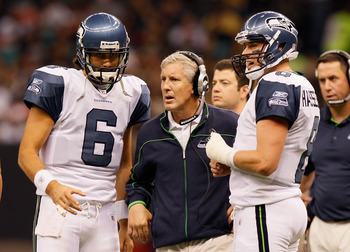 NEW ORLEANS - NOVEMBER 21:  Head coach Pete Carroll, quarterbacks Matt Hasselbeck #8 and Charlie Whitehurst #6 of the Seattle Seahawks against the New Orleans Saints at Louisiana Superdome on November 21, 2010 in New Orleans, Louisiana.  (Photo by Kevin C