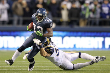 SEATTLE, WA - JANUARY 02:  Leon Washington #33 of the Seattle Seahawks is tackled by James Laurinaitis #55 of the St. Louis Rams during their game at Qwest Field on January 2, 2011 in Seattle, Washington.  (Photo by Otto Greule Jr/Getty Images)