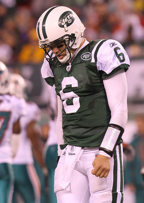 EAST RUTHERFORD, NJ - DECEMBER 12:  Mark Sanchez #6 of the New York Jets walks from the field after failing to convert a fourth down against the Miami Dolphins at New Meadowlands Stadium on December 12, 2010 in East Rutherford, New Jersey.  (Photo by Nick