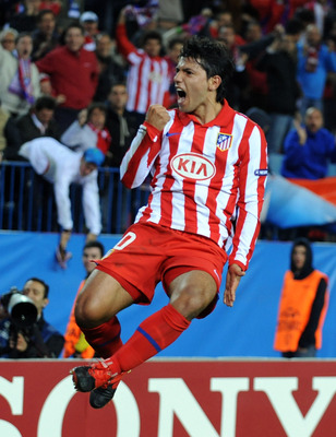 MADRID, SPAIN - NOVEMBER 03: Sergio Aguero of Atletico Madrid celebrates after scoring his second goal against Chelsea during the UEFA Champions League Group D match on November 3, 2009 in Madrid, Spain.  (Photo by Denis Doyle/Getty Images)