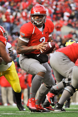 COLUMBUS, OH - NOVEMBER 27:  Quarterback Terrelle Pryor #2 of the Ohio State Buckeyes hands off against the Michigan Wolverines at Ohio Stadium on November 27, 2010 in Columbus, Ohio.  (Photo by Jamie Sabau/Getty Images)