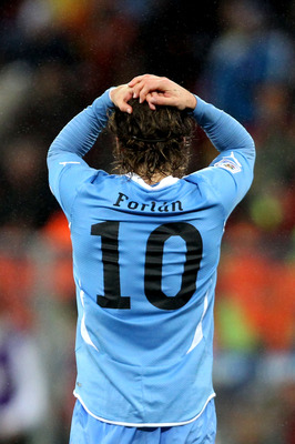 PORT ELIZABETH, SOUTH AFRICA - JULY 10: Diego Forlan of Uruguay shows his dejection after suffering defeat following the 2010 FIFA World Cup South Africa Third Place Play-off match between Uruguay and Germany at The Nelson Mandela Bay Stadium on July 10,