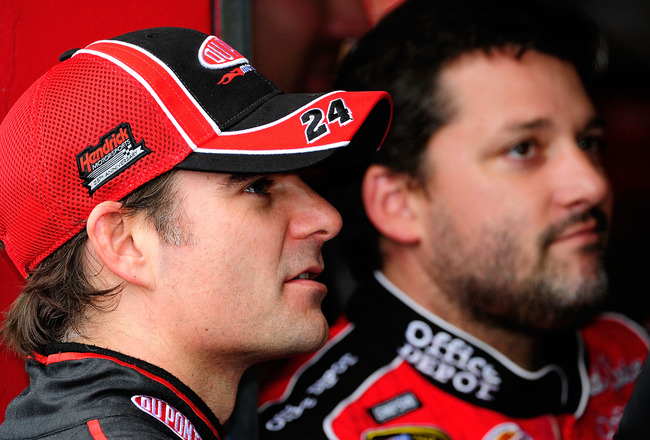 TALLADEGA, AL - OCTOBER 30:  Jeff Gordon (L), driver of the #24 DuPont Chevrolet, stands in the garage with Tony Stewart, driver of the #14 Office Depot/Old Spice Chevrolet, prior to practice for the NASCAR Sprint Cup Series AMP Energy 500 at Talladega Su