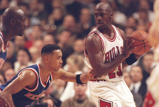 6 Dec 1995:  Guard John Starks of the New York Knicks tries to guard guard Michael Jordan of the Chicago Bulls at the United Center in Chicago, Illinois.  The Bulls won the game 101-94. NOTE TO USER:  It is expressly understood that the only rights Allspo