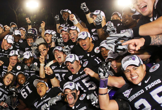 PASADENA, CA - JANUARY 01:  The TCU Horned Frogs celebrate with the Rose Bowl Championship Trophy after defeating the Wisconsin Badgers 21-19 in the 97th Rose Bowl game on January 1, 2011 in Pasadena, California.  (Photo by Jeff Gross/Getty Images)