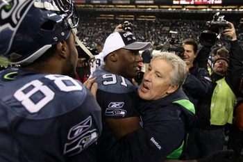 SEATTLE, WA - JANUARY 02:  Head coach Pete Carroll of the Seattle Seahawks hugs defensive end Chris Clemons #91 after defeating the St. Louis Rams 16-6 at Qwest Field on January 2, 2011 in Seattle, Washington.  (Photo by Otto Greule Jr/Getty Images)