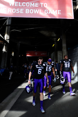 PASADENA, CA - JANUARY 01:  The TCU Horned Frogs take the field against the Wisconsin Badgers  prior to the 97th Rose Bowl game on January 1, 2011 in Pasadena, California.  (Photo by Kevork Djansezian/Getty Images)