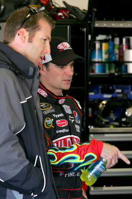 DAYTONA BEACH, FL - FEBRUARY 10:  Alan Gustafson (L), crew chief for Mark Martin (not pictured), driver of the #5 GoDaddy.com Chevrolet, and Jeff Gordon, driver of the #24 DuPont Chevrolet, talk in the garage during practice for the NASCAR Sprint Cup Seri