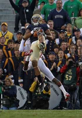 SOUTH BEND, IN - SEPTEMBER 25: Michael Floyd #3 of the Notre Dame Fighting Irish catches a pass as Barry Browning #31 of the Stanford Cardinal tries to defend at Notre Dame Stadium on September 25, 2010 in South Bend, Indiana. Stanford defeated Notre Dame