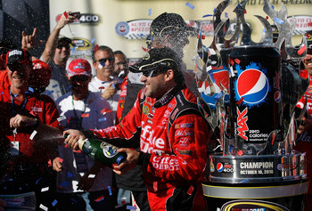 FONTANA, CA - OCTOBER 10:  Tony Stewart (R), driver of the #14 Office Depot Chevrolet, celebrates in victory lane after winning the NASCAR Sprint Cup Series Pepsi Max 400 on October 10, 2010 in Fontana, California.  (Photo by Tom Pennington/Getty Images f