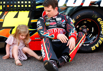 PHOENIX - APRIL 10: Jeff Gordon, driver of the #24 DuPont Chevrolet, sits with daughter Ella Sophia Gordon prior to the NASCAR Sprint Cup Series SUBWAY Fresh Fit 600 at Phoenix International Raceway on April 10, 2010 in Phoenix, Arizona.  (Photo by Geoff