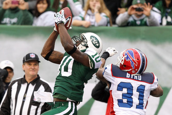 EAST RUTHERFORD, NJ - JANUARY 02:  Santonio Holmes #10 of the New York Jets completes a touchdown reception against Jairus Byrd #31 of the Buffalo Bills at New Meadowlands Stadium on January 2, 2011 in East Rutherford, New Jersey.  (Photo by Al Bello/Gett