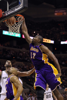 SAN ANTONIO, TX - DECEMBER 28:  Center Andrew Bynum #17 of the Los Angeles Lakers slams the ball against the San Antonio Spurs at AT&T Center on December 28, 2010 in San Antonio, Texas.  NOTE TO USER: User expressly acknowledges and agrees that, by downlo