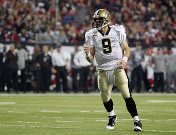 ATLANTA, GA - DECEMBER 27:  Quarterback Drew Brees #9 of the New Orleans Saints celebrates a touchdown pass in the first half during the game against the Atlanta Falcons at the Georgia Dome on December 27, 2010 in Atlanta, Georgia.  (Photo by Kevin C. Cox
