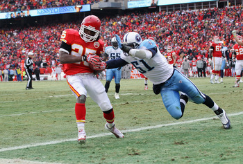 KANSAS CITY, MO - DECEMBER 26:  Jamaal Charles #25 of the Kansas City Chiefs makes a catch in the endzone for a touchdown as Gerald McRath #51 of the Tennessee Titans defends during the game on December 26, 2010 at Arrowhead Stadium in Kansas City, Missou