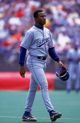 23 Apr 2000:  Carlos Perez #33 of the Los Angeles Dodgers walks on the field during the game against the Cincinnati Reds at Cinergy Field in Cincinnati, Ohio. The Dodgers defeated the Reds 11-3. Mandatory Credit: Harry How  /Allsport