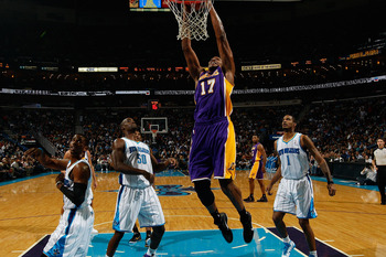 NEW ORLEANS, LA - DECEMBER 29:  Andrew Bynum #17 of the Los Angeles Lakers dunks the ball during the game against the New Orleans Hornets at the New Orleans Arena on December 29, 2010 in New Orleans, Louisiana.   NOTE TO USER: User expressly acknowledges