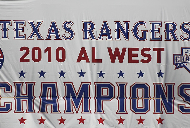 ARLINGTON, TX - SEPTEMBER 29:  A Texas Rangers AL West champions banner hangs at Rangers Ballpark in Arlington on September 29, 2010 in Arlington, Texas.  (Photo by Ronald Martinez/Getty Images)