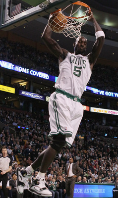 BOSTON, MA - DECEMBER 08:  Kevin Garnett #5 of the Boston Celtics dunks the ball in the first half against the Denver Nuggets on December 8, 2010 at the TD Garden in Boston, Massachusetts. NOTE TO USER: User expressly acknowledges and agrees that, by down