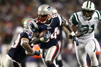 FOXBORO, MA - DECEMBER 06:  Deion Branch #84 of the New England Patriots scores on a 25-yard touchdown reception in the first quarter against Antonio Cromartie #31 of the New York Jets at Gillette Stadium on December 6, 2010 in Foxboro, Massachusetts.  (P
