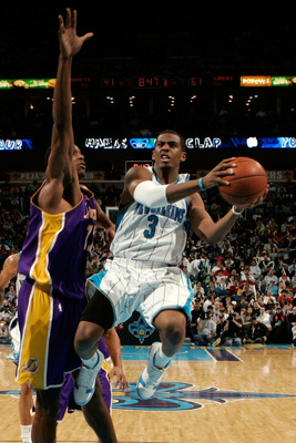 NEW ORLEANS - DECEMBER 23:  Chris Paul #3 of the New Orleans Hornets makes a shot over Andrew Bynum #17 of the Los Angeles Lakers on December 23, 2008 at the New Orleans Arena in New Orleans, Louisiana. The Lakers defeated the Hornets 100-87.   NOTE TO US