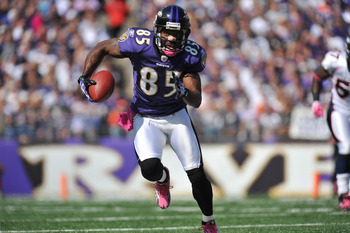 BALTIMORE, MD - OCTOBER 10:  Derrick Mason #85 of the Baltimore Ravens runs the ball against the Denver Broncos at M&T Bank Stadium on October 10, 2010 in Baltimore, Maryland. Players wore pink in recognition of Breast Cancer Awareness Month. The Ravens l