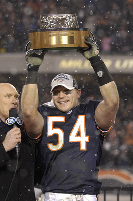 Brian Urlacher holds the George S. Halas trophy after the Bears won the 2007 NFC Championship game between the Chicago Bears and New Orleans Saints at Soldier Field in Chicago, Illinois on January 21, 2007.  (Photo by Al Messerschmidt/Getty Images)