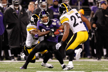 BALTIMORE, MD - DECEMBER 05:  T.J. Houshmandzadeh #84 of the Baltimore Ravens holds onto the ball against the Pittsburgh Steelers during the second quarter of the game at M&T Bank Stadium on December 5, 2010 in Baltimore, Maryland.  (Photo by Geoff Burke/