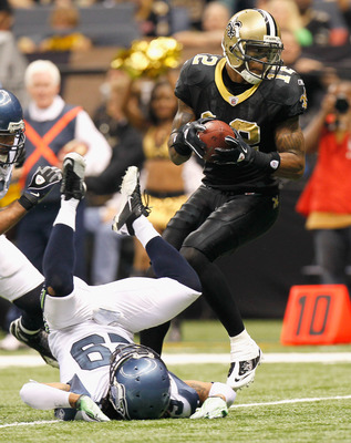 NEW ORLEANS - NOVEMBER 21:  Marques Colston #12 of the New Orleans Saints scores a touchdown after running over Earl Thomas #29 of the Seattle Seahawks at Louisiana Superdome on November 21, 2010 in New Orleans, Louisiana.  (Photo by Kevin C. Cox/Getty Im