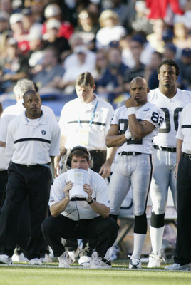 SAN DIEGO - JANUARY 26:  Head coach Bill Callahan and wide receiver James Jett #82 of the Oakland Raiders watch the game against the Tampa Bay Buccaneers during Super Bowl XXXVII at Qualcomm Stadium on January 26, 2003 in San Diego, California.  The Bucca