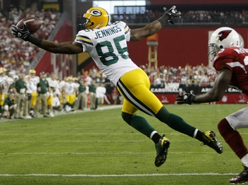 GLENDALE, AZ - JANUARY 10:  Wide receiver Greg Jennings #85 of the Green Bay Packers catches the ball for a touchdown against the Arizona Cardinals during the third quarter of the 2010 NFC wild-card playoff game at University of Phoenix Stadium on January