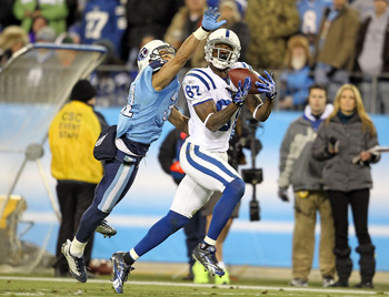 NASHVILLE, TN - DECEMBER 09:  Reggie Wayne #87 of the Indianapolis Colts catches a pass while defended by Cortland Finnegan #31  of the Tennessee Titans during the NFL game at LP Field on December 9, 2010 in Nashville, Tennessee.  (Photo by Andy Lyons/Get