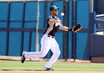 PEORIA, AZ - MARCH 04:  Infielder Dustin Ackley #13 of the Seattle Mariners fields a ground ball out against the Cincinnati Reds during the spring training game at Peoria Stadium on March 4, 2011 in Peoria, Arizona.  (Photo by Christian Petersen/Getty Ima