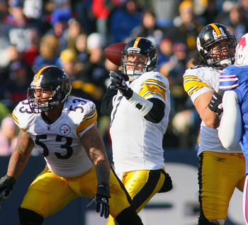 ORCHARD PARK, NY - NOVEMBER 28:  Ben Roethlisberger #7 of the Pittsburgh Steelers throws with protection from Maurkice Pouncey #53 and Chris Kemoteatu #68  against the Buffalo Bills at Ralph Wilson Stadium at Ralph Wilson Stadium on November 28, 2010 in O