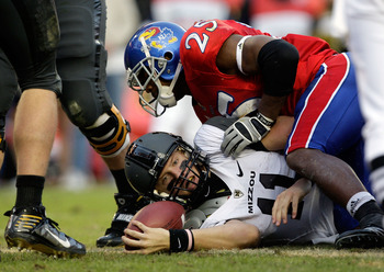 KANSAS CITY, MO - NOVEMBER 28:  Quarterback Blaine Gabbert #11 of the Missouri Tigers is tackled short of the end zone by Darrell Stuckey #25 of the Kansas Jayhawks during the game at Arrowhead Stadium on November 28, 2009 in Kansas City, Missouri.  (Phot