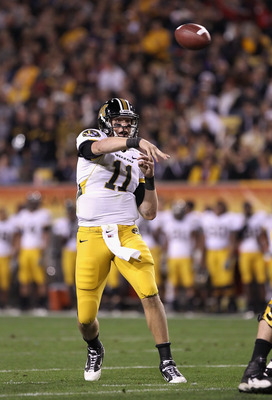 TEMPE, AZ - DECEMBER 28:  Quarterback Blaine Gabbert #11 of the Missouri Tigers throws a pass during the Insight Bowl against the Iowa Hawkeyes at Sun Devil Stadium on December 28, 2010 in Tempe, Arizona.  (Photo by Christian Petersen/Getty Images)