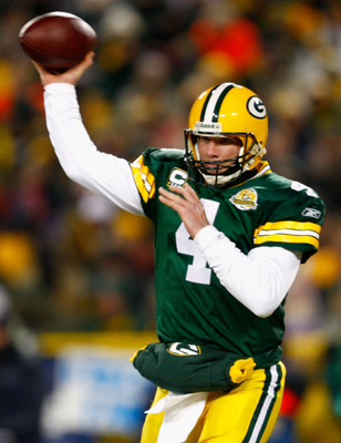 GREEN BAY, WI - JANUARY 20:  Quarterback Brett Favre #4 of the Green Bay Packers throws a pass against the New York Giants during the NFC championship game on January 20, 2008 at Lambeau Field in Green Bay, Wisconsin.  (Photo by Jamie Squire/Getty Images)
