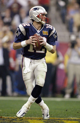 HOUSTON, TX - FEBRUARY 1:  Quarterback Tom Brady #12 of the New England Patriots drops back to pass against the Carolina Panthers during Super Bowl XXXVIII at Reliant Stadium on February 1, 2004 in Houston, Texas. The Patriots won 332-29 to claim their se