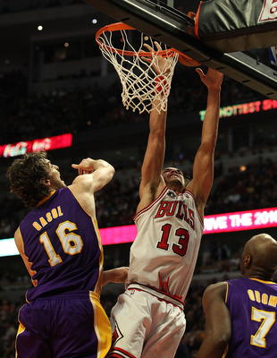 CHICAGO, IL - DECEMBER 10: Joakim Noah #13 of the Chicago Bulls puts up a shot over Pau Gasol #16 and Lamar Odom #7 of the Los Angeles Lakers at the United Center on December 10, 2010 in Chicago, Illinois. The Bulls defeated the Lakers 88-84. NOTE TO USER