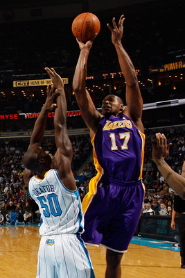 NEW ORLEANS, LA - DECEMBER 29:  Andrew Bynum #17 of the Los Angeles Lakers shoots the ball over Emeka Okafor #50 of the New Orleans Hornets at the New Orleans Arena on December 29, 2010 in New Orleans, Louisiana.   NOTE TO USER: User expressly acknowledge