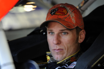 FORT WORTH, TX - NOVEMBER 06:  Jamie McMurray, driver of the #1 Bass Pro Shops/Arctic Cat Chevrolet, sits in his car in the garage area during practice for the NASCAR Sprint Cup Series AAA Texas 500 at Texas Motor Speedway on November 6, 2010 in Fort Wort