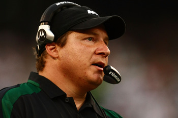 EAST RUTHERFORD, NJ - SEPTEMBER 14:  Head coach Eric Mangini of the New York Jets gives instructions against the New England Patriots on September 14, 2008 at Giants Stadium in East Rutherford, New Jersey. The Patriots won the match 19-10.  (Photo by Chri