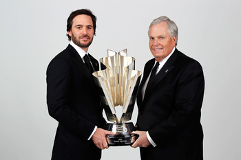 LAS VEGAS, NV - DECEMBER 03:  (L-R) Five-time champion Jimmie Johnson poses with team owner Rick Hendrick and the Sprint Cup trophy during the NASCAR Sprint Cup Series awards banquet at the Wynn Las Vegas Hotel on December 3, 2010 in Las Vegas, Nevada.  (