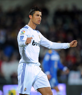 GETAFE, SPAIN - JANUARY 03:  Cristiano Ronaldo of Real Madrid celebrates after scoring Real's first goal from the penalty spot during the La Liga match between Getafe and Real Madrid at Coliseum Alfonso Perez stadium on January 3, 2011 in Getafe, Spain.