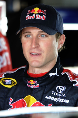 HOMESTEAD, FL - NOVEMBER 20:  Kasey Kahne, driver of the #83 Red Bull Toyota, stands in the garage during practice for the NASCAR Sprint Cup Series Ford 400 at Homestead-Miami Speedway on November 20, 2010 in Homestead, Florida.  (Photo by John Harrelson/